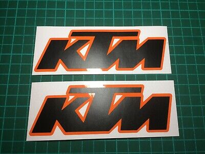 (X2) KTM Logo Decals Stickers 130x45mm MATTE BLACK / GLOSS ORANGE BACKGROUND • 5.99£